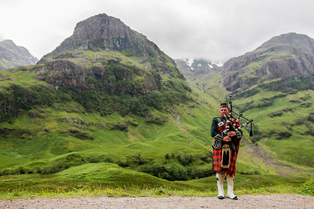 Photo of Scottish countryside and Bagpiper