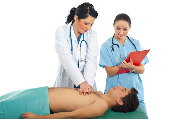 Photo of doctor training a nurse in CPR
