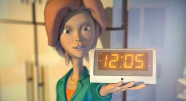 Video still showing woman holding digital clock that is actually a memory reminder called Rosie